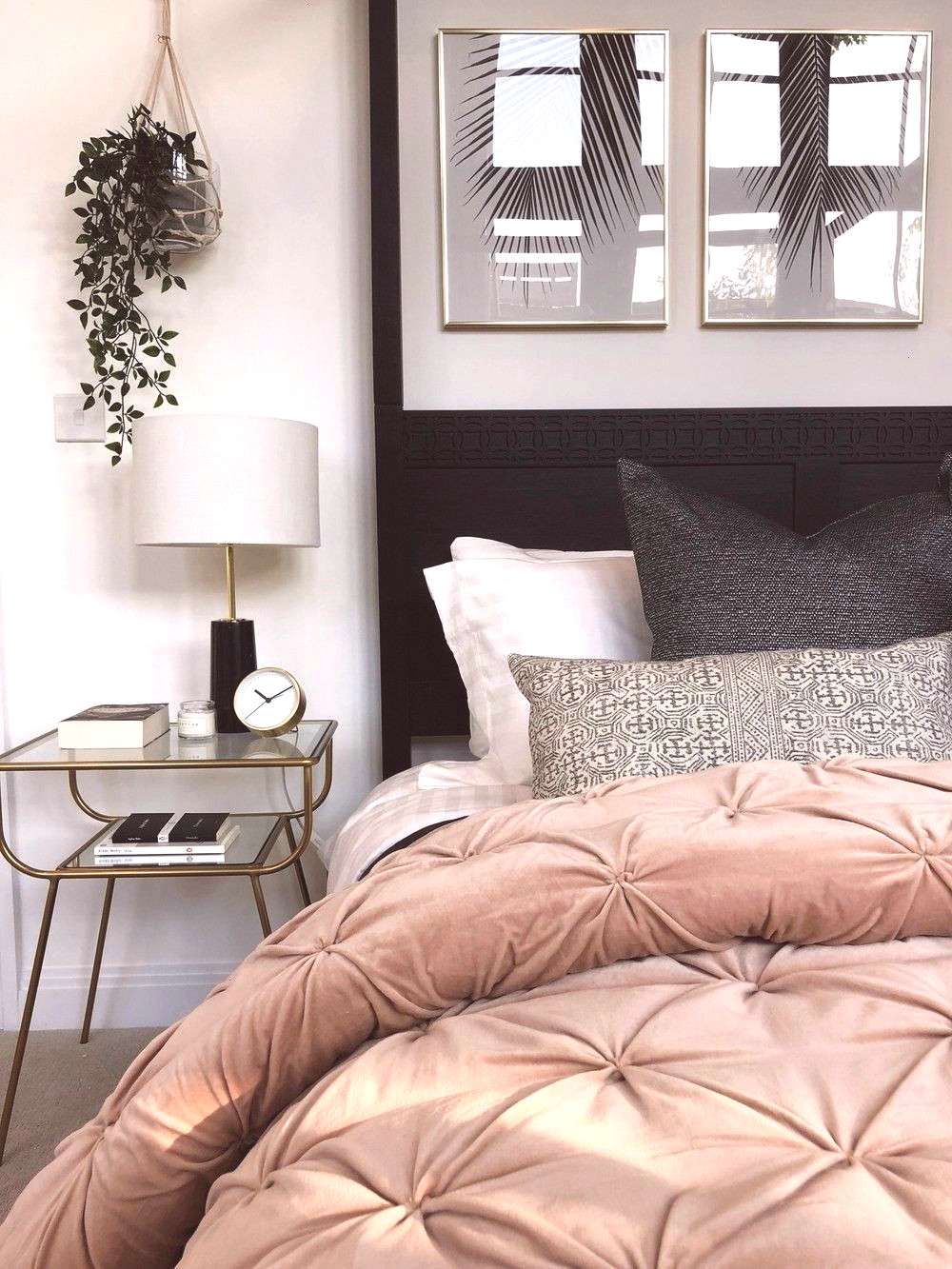 four poster bed, leaf artwork, blush quilted bed throw, brass bedside tables in the master bedroom